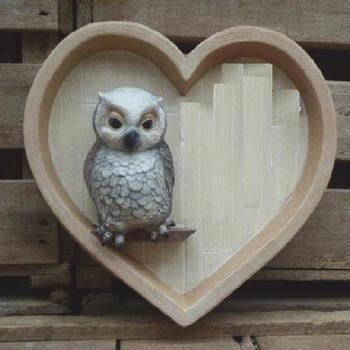 hart muur met uil