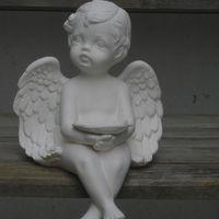 engel afhangend handen open