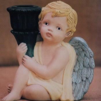 engel zit kandelaar rechts