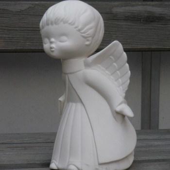 engel kussend jongen