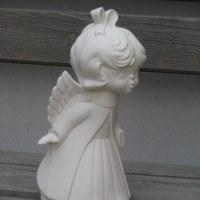 engel kussend meisje