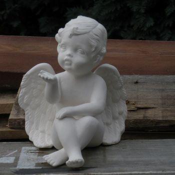 engel zit hand knie / blazend