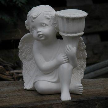 engel zit kandelaar links