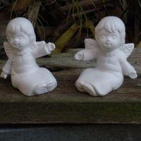 engeltje klein zit armen open (2)