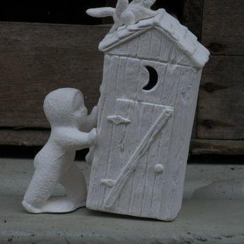 baby sneeuw met huisje